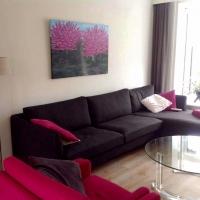 Schilderij roze bloesem in huiskamer